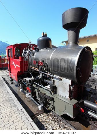 ST. WOLFGANG, AUSTRIA - JULY 8:The steam locomotive of a vintage cogwheel railway at Schafberg Peak (1783m) This track is steepest railway in Austria on July 8, 2012 in St. Wolfgang.