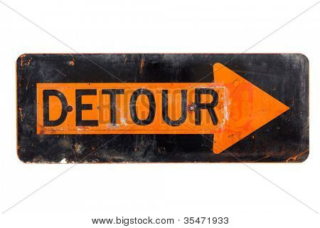 A very old, orange and black detour sign on a white background