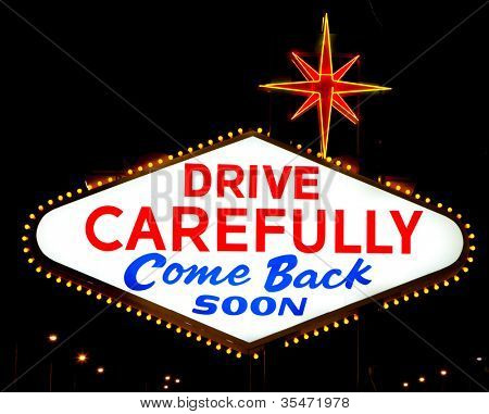 """The backside of the famous Las Vegas sign reading """"drive carefully, come back soon"""""""