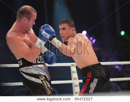 ODESSA, UKRAINE - JULY 21: Vyacheslav Uzelkov (left) vs Mohamed Belkacem in fight for WBO Inter-Continental light heavyweight title in Odessa, Ukraine at July 21, 2012