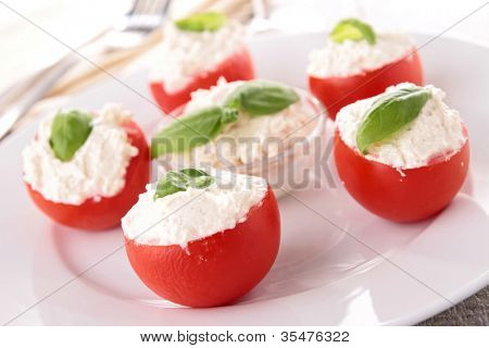 stuffed tomato with cheese and basil