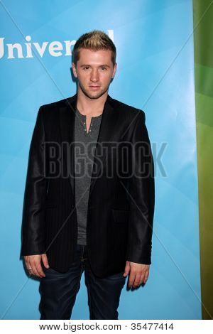 LOS ANGELES - JUL 25:  Travis Wall arrives at the NBC Universal Cable TCA Summer 2012 Press Tour at Beverly Hilton Hotel on July 25, 2012 in Beverly Hills, CA