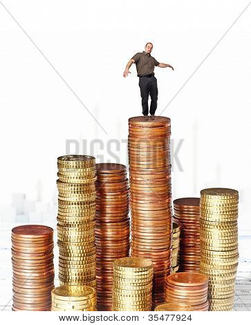 young man on piles of euro coins