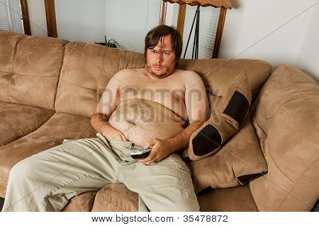 Fat Guy Laying On The Couch