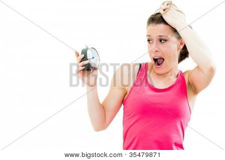 shocked,young beautiful woman holding a clock on a white background