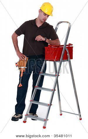 Tradesman looking at his watch