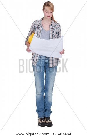 Tradeswoman looking at a blueprint