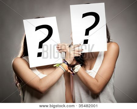 young women with interrogation symbols in front of their faces