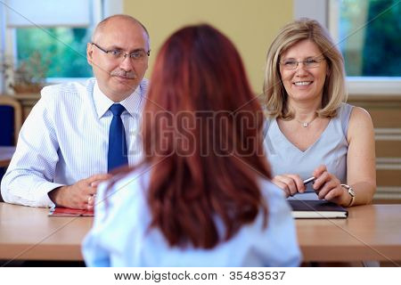 Job interview, two senior colleagues from hr department and young applicant