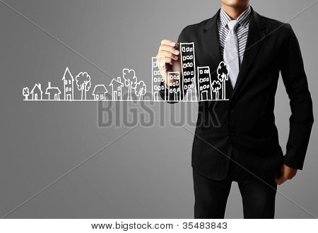 businessman drawing a building