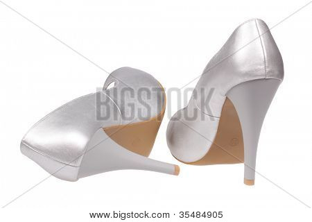 A pair of silver women's heel shoes isolated over white with clipping path.