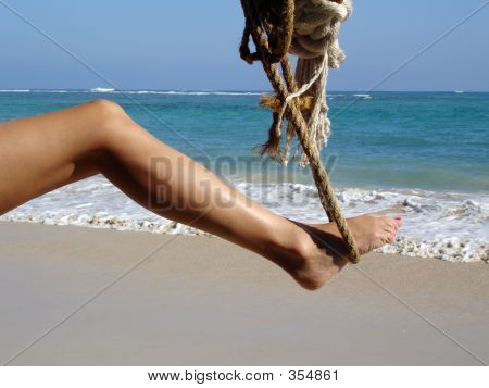 Woman's Leg In Rope Swing