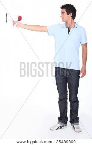 a teenage boy using a megaphone like a gun