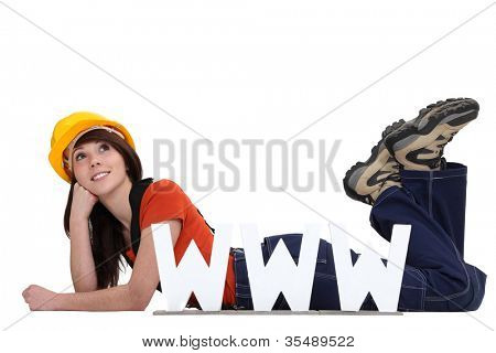 craftswoman lying on the floor with face resting on fist and www symbol