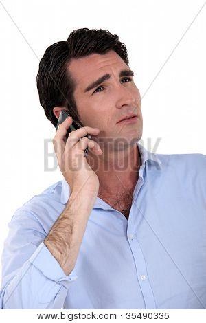 An unhappy man over the phone.