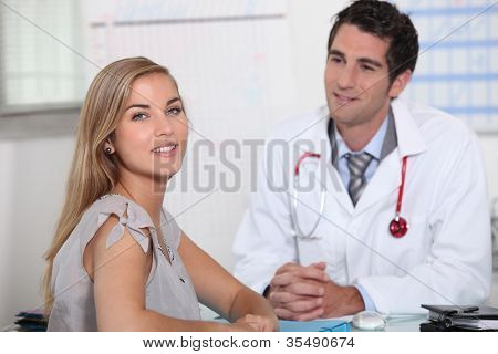 Young female patient consulting with her doctor
