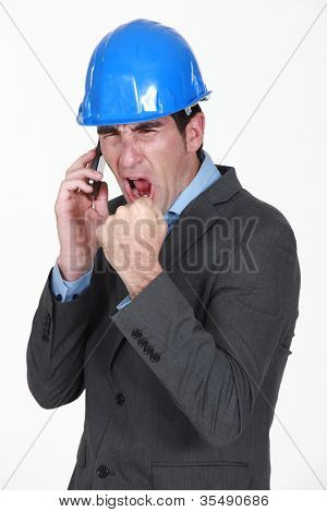 angry real estate businessman shouting on his cell phone