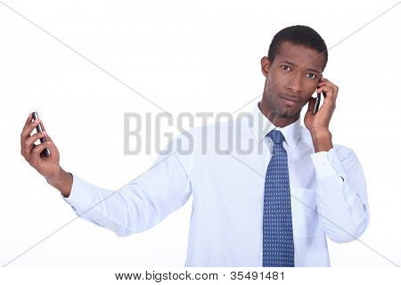 Man passing two phone calls