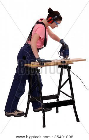 Woman carpenter using a jigsaw.