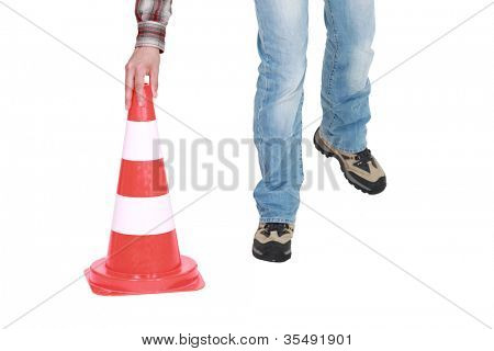 Setting down a traffic pylon