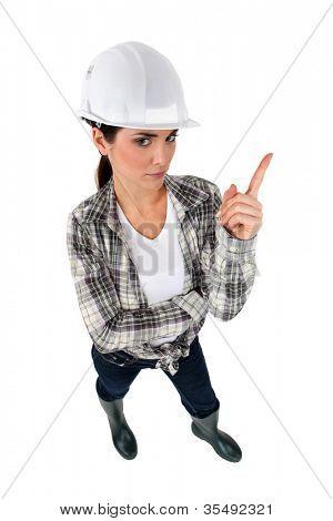 Tradeswoman shaking her finger