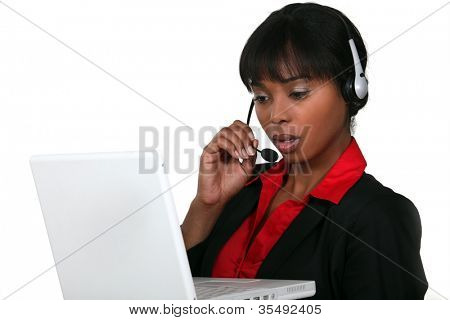 Businesswoman wearing a headset with a laptop