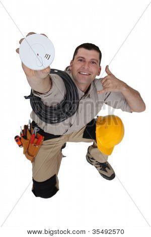 Electrician with a smoke alarm