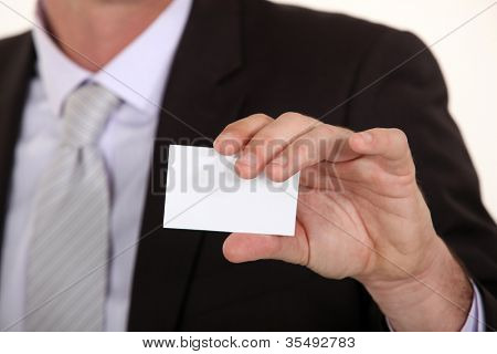 Man showing empty business card