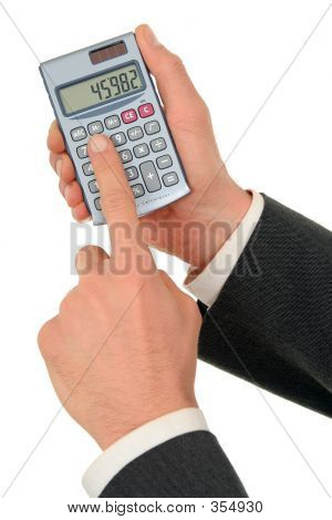 Businessman's Hands Holding A Calculator
