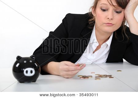 Woman counting her pennies