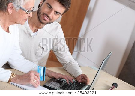 Grandmother and grandson shopping on-line