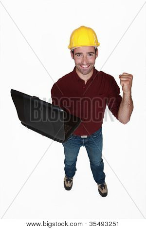 tight-fisted craftsman with laptop