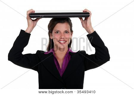 Woman holding a laptop on her head