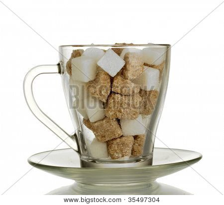 white refined sugar and Lump brown cane sugar cubes in glass cup isolated on white