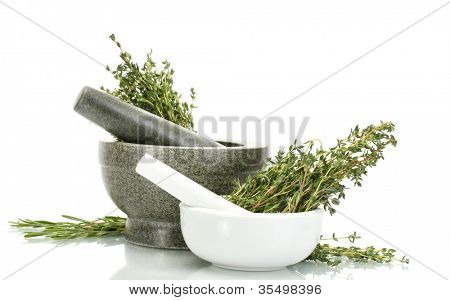 mortars with fresh green thyme and rosemary isolated on white