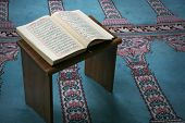 picture of namaz  - young muslim girl reading the Koran in mosque - JPG