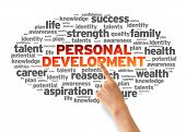 foto of self assessment  - Hand pointing at a Personal Development Word Cloud on white background - JPG