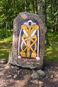 pic of rune  - Colorful rune stone in Norway in woods - JPG