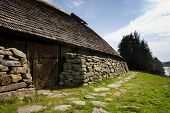 foto of longhouse  - A viking longhouse on the coast of Norway - JPG