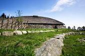 picture of longhouse  - A viking longhouse on the coast of Norway - JPG