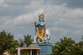 stock photo of krishna  - this statue of lord krishna is situated on the way from bangalore to mysore in karnataka india - JPG