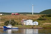 pic of acadian  - Picturesque rural scene with water and windmill on hillside - JPG