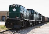 pic of railcar  - Diesel railroad Locomotive engine on a side track - JPG