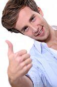 image of youg  - Youg man giving the thumb up - JPG