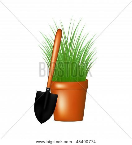Garden trowel and grass in flowerpot