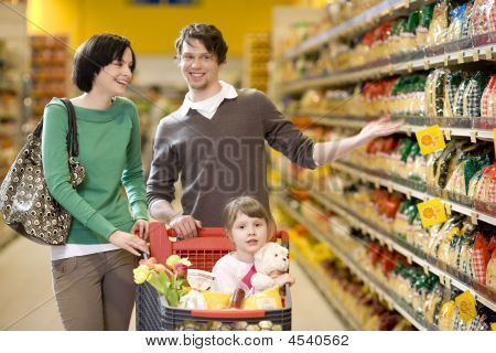 Young Family At Supermarket