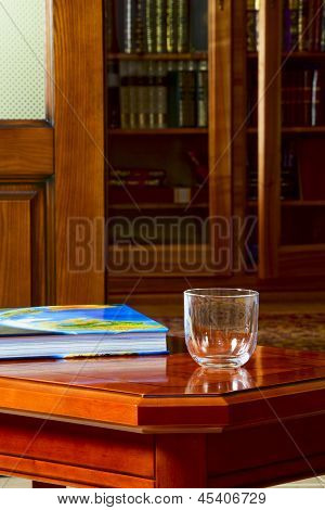 The Book And A Glass On The Coffee Table