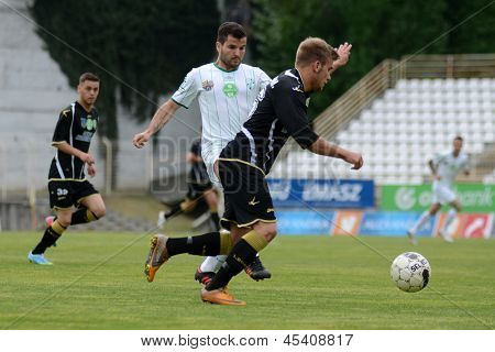 KAPOSVAR, HUNGARY - APRIL 27: Pedro Sass (in white) in action at a Hungarian National Championship soccer game - Kaposvar (white) vs Szombathely (black) on April 27, 2013 in Kaposvar, Hungary.