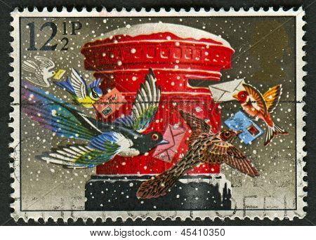 "UK - CIRCA 1983: A stamp printed in UK shows image of The ""Christmas Post"" (pillar-box), circa 1983."