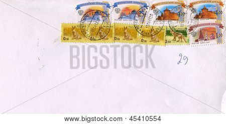 RUSSIA - CIRCA 2013: A stamp printed in Russia shows image of the Ryazan, Nizhny Novgorod, and Astrakhan Kremlin, Hare, Wolf, circa 2013.